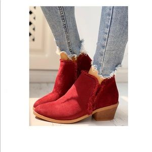 Red faux suede booties with fringe trim